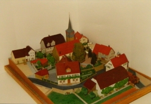 A model of the church in Affalterbach as it used to look, possibly including the schoolhouse.