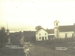 Corner of what is today Naugart Drive and Berlin Lane, c. 1909. The frame schoolhouse on the right replaced the original log schoolhouse where Hoffmann was called and organized the first Lutheran congregation in the area on March 11, 1861.